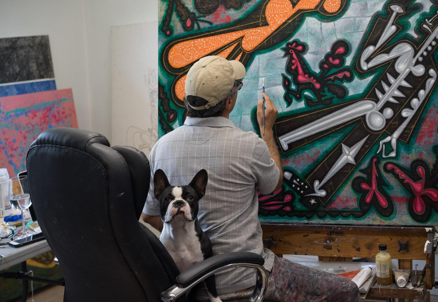 Carlos Luna working with his dog Cocoa, 2018